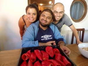 Alessandra, Bilal and Michele cooking stuffed pepers
